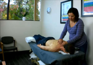 Dr Danielle Smith Lockwood performs acupuncture on a patient at Terrain Wellness, Portland, Oregon